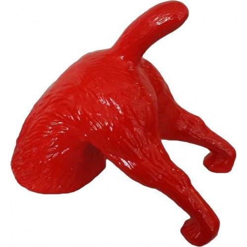 Statue chien terrier qui creuse rouge